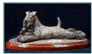 Kerry Blue Terrier Dog - Lying with Irish Teddy Bear on Rug base